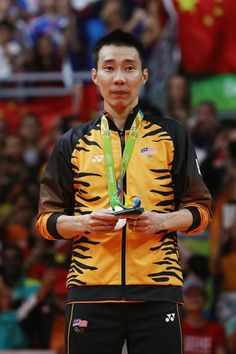 Silver medalist Chong Wei Lee of Malaysia poses on the podium during the medal ceremony for the Men's Singles Badminton on Day 15 of the Rio 2016 Olympic Games at Riocentro - Pavilion 4 on August 20, 2016 in Rio de Janeiro, Brazil.