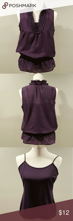 """Alfani Purple Blouse Alfani purple top with ruffle neckline. Two pieces - top blouse is a lightweight sheer cotton/silk blend. Inside cami is a poly/spandex blend cami that has adjustable straps. Cinched waist with peplum detail. So feminine!  Sized 10 petite as elastic band sits at a length better for shorter torsos. But since top blouse fits slightly generous, can fit some 10 misses too.  Very good pre-owned condition.   Approx. 26"""" length (20"""" to elastic), 19.5"""" bust on top blouse. Alfani…"""