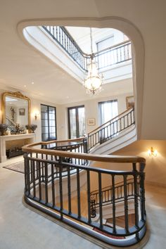 American Oak Handrail | Continuous | Craftsmanship | Wrought Iron Balustrade | Marble Stair | Classic | Traditional | Wreathing Scroll