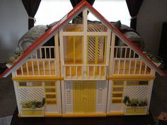 Barbie Dream House. I used to have one of these. It was all decked out. I distinctly remember the late 70's style, but mom bought it for me in 1983. It was amazing! Even as a 5 year old, I was a Liberal. My 2 barbies were Lesbians that lived in this house with their dog and 2 cats.