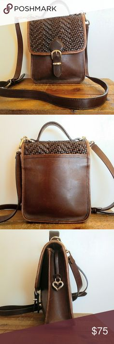 """Vintage Brighton Leather and Wicker Crossbody Bag Gorgeous vintage Brighton crossbody bag made of smooth brown leather with a woven wicker panel on the flap and a detachable strap. Magnet closure with a zip pocket inside. Inside zip has a Brighton heart charm as the pull, which hangs down the outside of the bag. Good vintage condition with light scratching and markings throughout and some marks on the metal.   Height: 9"""" Length: 7"""" Depth: 3.25"""" Strap drop: 21.5-24.5"""" Brighton Bags Crossbody…"""