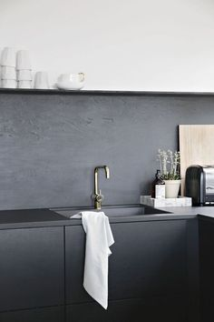 After installing a dramatic kitchen system in black oak in her Drammen, Norway, home, blogger Nina Holst of Stylizimo took a hands-on, low-cost approach to the backsplashes. She made them herself usin