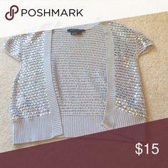 Shrug with Sequins A blingy 100% silk shrug suitable to be worn over any dress or casually with a tank and jeans. Very versatile! BCBGMaxAzria Sweaters Shrugs & Ponchos