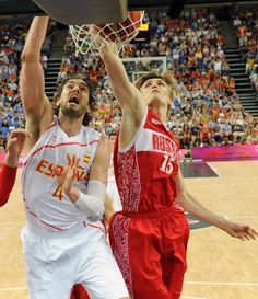 Russia's Andrei Kirilenko and Spain's Pau Gasol battle for the ball during a men's semifinal basketball game at the 2012 Summer Olympics, Friday, Aug. 10, 2012, in London. (AP Photo/Mark Ralston, Pool)