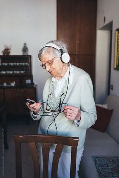 Elderly woman listening to music by mobydick | Stocksy United