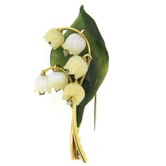 Beautiful Lily of the Valley Mother of Pearl Diamond Nephrite Gold Brooch. Beautiful and delicate brooch, set in 18k gold, featuring carved nephrite leaf and mother of pearl lily of the valley flowers,each decorated with dangling diamond. Brooch measures 65mm x 30mm. Weight of the piece - 19.2 grams