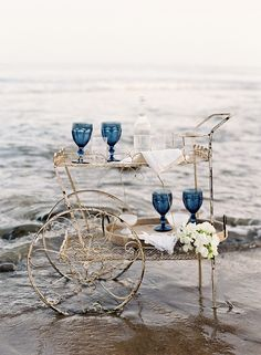 A beautiful nautical styled shoot by Jose Villa, styled by Joy de Vivre.  www.reveriemag.com  Florals: Kelly Kaufman // Stationery: Feast Art and Calligraphy // Rentals: Found Vintage Rentals // Table Setting: Small Masterpiece and Greta Bean Home // Cake: The Scootabaker  // Model: Tatiana from Sirena Models // Hair & Makeup: TEAM // Dresses: Samuelle Couture and Sarah Janks