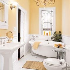 classically elegant large yellow bathroom with chandelier and claw foot bathtub. Trending in Bathroom Design: Yellow Bathrooms from Bathroom Bliss by Rotator Rod Bathroom Trending in Bathroom Design: Yellow Bathrooms Bad Inspiration, Bathroom Inspiration, Bad Styling, Cottage Style Bathrooms, Country Bathrooms, Bathroom Colors, Bathroom Ideas, Bathroom Yellow, Bathroom Designs