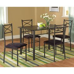 @Overstock.com - Valencia Metal Dining Set (5-Piece) - Your guests will think they're at a Tuscan villa when they sit down at this exquisite metal dining set. Made out of engineered wood and metal, its rugged construction will last you a long time, and the cushioned seats will encourage long conversations.  http://www.overstock.com/Home-Garden/Valencia-Metal-Dining-Set-5-Piece/6359430/product.html?CID=214117 $179.99
