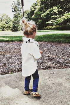 I can't stop looking at this kid! My child will always wear a messy bun :)