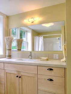 traditional bathroom by David Neiman Architects light yellow with sandy brown color palette