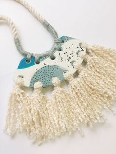 Hey, I found this really awesome Etsy listing at https://www.etsy.com/listing/505528630/polymer-clay-pendant-with-tassels