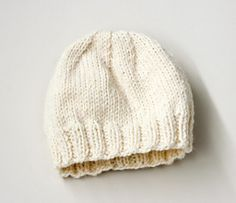 This classic beanie is knit in stockinette with a ribbed border, and can be worked up with just one skein on double-pointed needles. (Lion Brand Yarn)