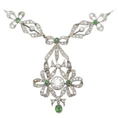 1900s 0.15 Carat Peridot 2.53 Carat Diamond Platinum Pendant | From a unique collection of vintage chain necklaces at https://www.1stdibs.com/jewelry/necklaces/chain-necklaces/
