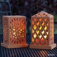 Terracotta Lanterns  Openwork terracotta lanterns emit a lovely glow when