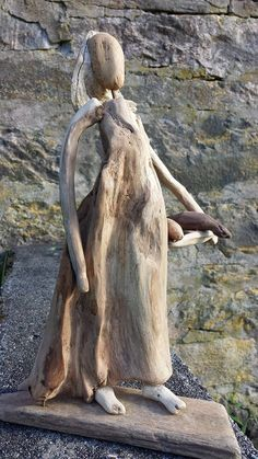 LADY WITH FISCH. Sandra's driftwood