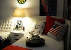 teenage boy room idea with white bed and American flag pillow