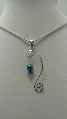Simple curlicue sterling silver pendant with hanging pearl