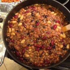 Pork and beans plus three other kinds of beans simmer in a Dutch oven with ground beef and crumbled bacon for a big pot of beans that makes a hearty main dish. No soaking required.