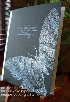handmade card ... gorgeous giant butterfly from Stampin' Up! .... black card base ... stamped in white craft ink ... embossed with Iridescent ice to make the shimmery blues .... luv it!!