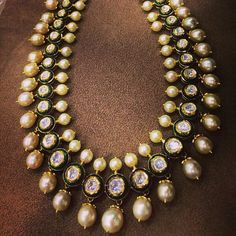 Polki uncut diamonds string with south sea pearls necklace. #IndianJewellery #OnlineShopping