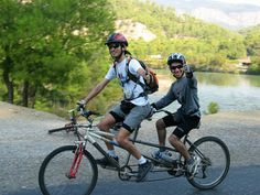 The tandem bicycle or twin is a form of bicycle (occasionally, a tricycle) designed to be ridden by more than one person. The term tandem refers to the seating arrangement (fore to aft, not side by side), not the number of riders. A bike with two riders side by side is called a sociable.