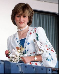 HRH Diana, Princess of Wales leaving Gibraltar (on the Royal Yacht Britannia) for her honeymoon cruise in July 1981. Her dress is by Donald Campbell and her pearl choker with a turquoise embellished clasp was a gift for her 18th birthday from her family. Diana wore the choker with its turquoise accented clasp in front, like this, and sometimes with the clasp in back.