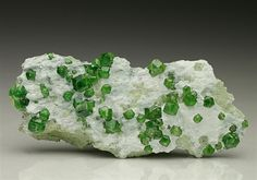 Andradite Garnet var Demantoid measuring to 5mm on the characteristic white matrix from the Thetford Mines, Canada.