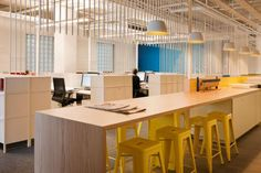Whybin\TBWA, South Melbourne | Bates Smart.  Collaborative area right next to individual working space.