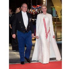 November 2016: Prince Albert's wife looked regal arriving to the Monaco National Day Gala wearing a white embellished gown by one of her favorite designers, Akris. Charlene paired the stunning dress with a matching floor-length coat.  Photo: PLS Pool/Getty Images
