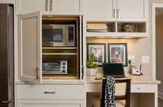 An appliance garage conceals the microwave and toaster oven