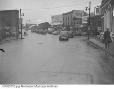 1946: East Main Street is shown at the corner of North Goodman Street. Automobiles are seen traveling along Main Street, while pedestrians walk the sidewalks. Various businesses line the street, including the Lincoln-Alliance Bank on the far right. The view faces west. Main Street, Street View, Rochester New York, Pedestrian, Vintage Photography, Ontario, Maine, Sidewalks, Potpourri