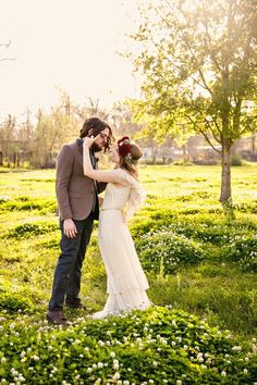 Sweet bride and groom. Floral hair piece by Poppy & Mint Floral Company, dress from Gossamer, image by Stevie Ramos Photography. #wedding
