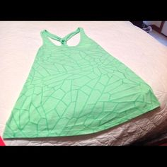 Tank  shirt with twisted back Lime Green tank type top . Wear over swim suit or bandeau top. Lime green with dark green designs.  Used Old Navy Tops Tank Tops