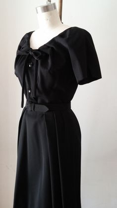 The PERFECT 50s Christian Dior little black dress! The dress is wool gaberdine and lined in silk, has glass buttons, snaps and hook and eye closures