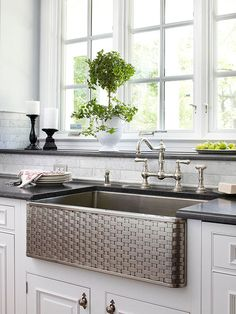 Can't get enough of the basket-weave pattern on this apron-front sink! Grab ideas for your remodel with the before and after shots of this elegant kitchen makeover: New Kitchen, Elegant Kitchens, Kitchen Decor, Kitchen Remodel, Home Kitchens, Kitchen Redo, Beautiful Kitchens, Kitchen Dining Room, Kitchen Inspirations
