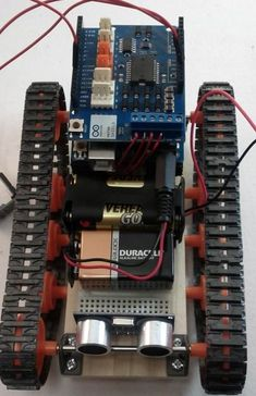 See how to build Robot with tracks, infrared remote control, and an ultrasonic sensor. Learn how to build a robot easily!