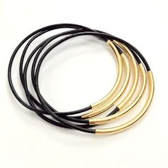 Leather and Silver Stacked Bangle Bracelets, set of 5 in black and gold. $12.00, via Etsy.