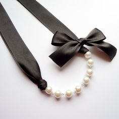 Pearl necklace on black ribbon with bow