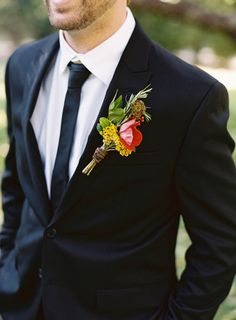 Big, rustic boutonniere: http://www.stylemepretty.com/2015/04/13/rustic-elegance-at-old-edwards-inn-spa-2/ | Photography: Virgil Bunao - http://virgilbunao.com/
