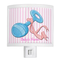 Light up your baby's nursery with this Girl Baby Rattle Night Light that features a light pink and white striped background that is customiz...