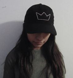 This is a hand embroidered, crown design, black baseball cap. One size fits all because of the Velcro adjustments in the back. All embroidery is