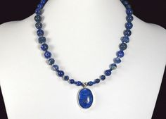 This handmade lapis and sterling silver necklace makes the perfect gift! QuirkyGirlz.com