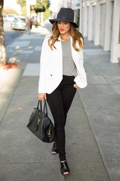 Julia of Gal Meets Glam dresses up her black skinnies with a blazer and mules.