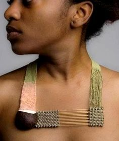 HANNAH WOODWARD Mayan Glyphs, neckpiece, 2011, leather, vegetable ivory, gold-plated brass, thread