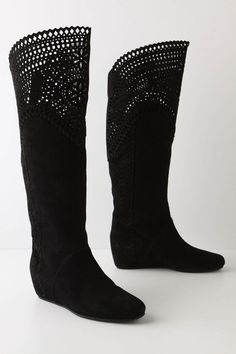 Leather and suede flat boots with cutout detail.
