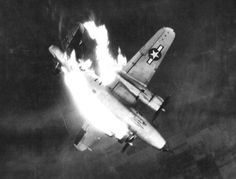 A U.S. Army Air Forces Martin B-26G-11-MA Marauder (s/n 43-34565) from the 497th Bombardment Squadron, 344th Bombardment Group, 9th Air Force, enveloped in flames and hurtling earthward after enemy flak scored a direct hit on the left engine while aircraft was attacking front line enemy communications center at Erkelenz, Germany.