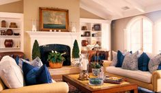Living Room by Barclay Butera: khaki with navy blue & white: paisley & striped throw pillows