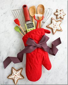 I love this idea for  - especially for someone who does not already have her kitchen set up.  Just fill a cute oven mitt with all your favorite kitchen tools, and tie with a big grosgrain ribbon.
