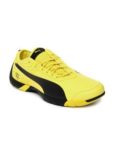 san francisco ff415 dba84 Love this  sneakers... part  Puma part  Ferrari!! Round toed, yellow sport  shoes with black accents, assymetrical lace-ups and top low styling
